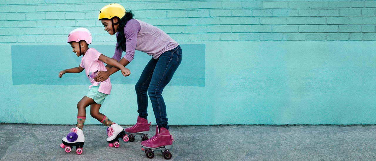Woman and daughter on Roller skates