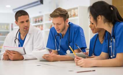 Photo of doctors reviewing notes together