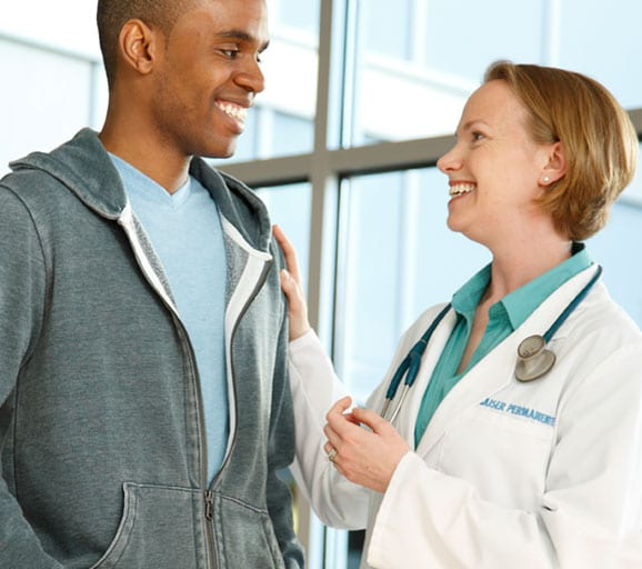 Female doctor greeting male patient