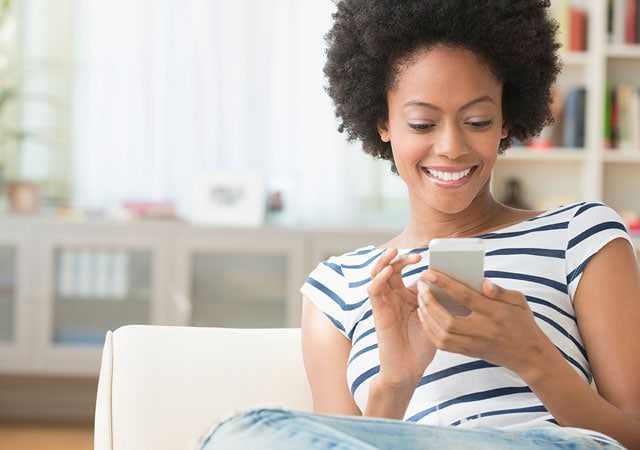 Photo of lady using smartphone on couch