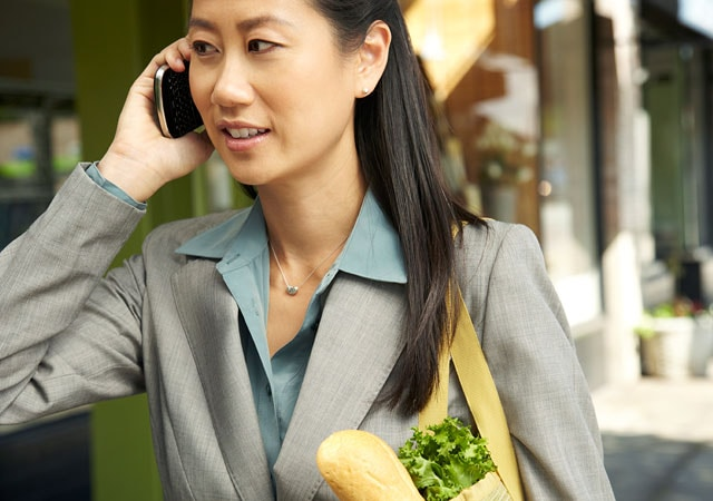 Photo of businesswoman walking and talking on phone