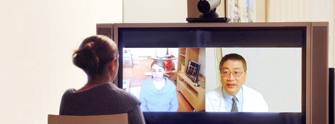 Photo of woman having a video visit with her doctor