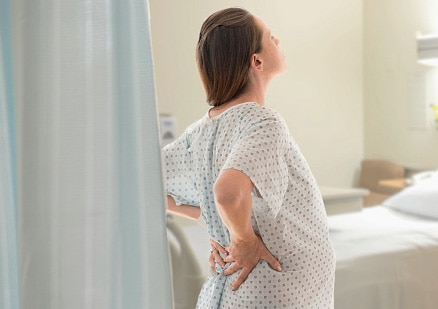woman in labor standing
