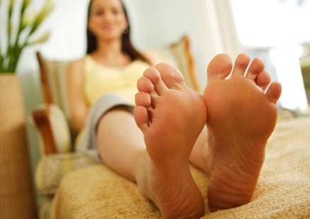 woman sitting showing swollen feet