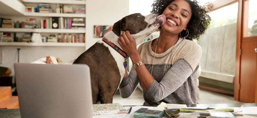 Happy woman and her dog at home