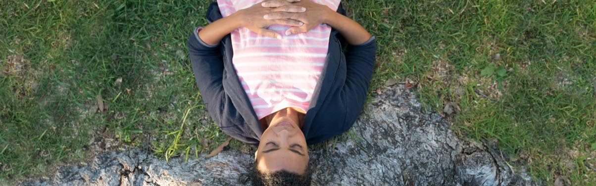 Woman laying outside looking peaceful