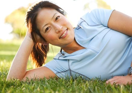 Woman relaxing outside looking at camera