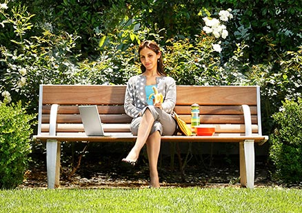 woman sitting on a park bench looking thoughtful