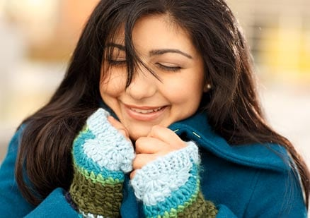 Woman smiling wearing a scarf