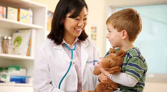 Doctor smiling with young boy