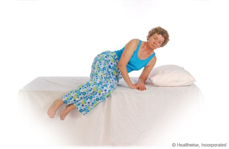 Pictures of protecting your back as you lie down: Step 2 of 3 - Supporting your back