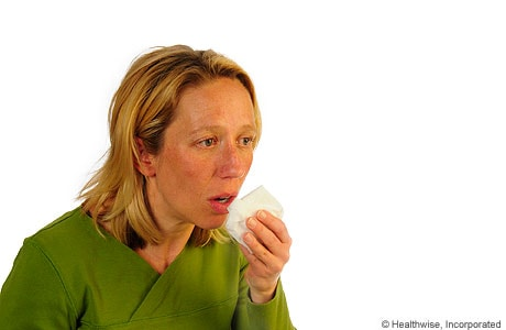 A person coughing to loosen mucus